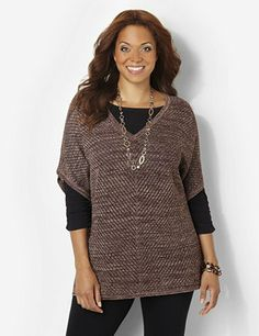Discover perfectly versatile pieces from our AnyWear Collection that mix, match and pack beautifully, wherever life takes you. Shine bright in this illuminating, poncho-style top. Metallic lurex yarn glows along the open fabric in a flattering, mitered pattern. Sleeves are stitched at the armholes, but feature a draping, poncho design. V-neck top is complete with an asymmetrical hem with slit sides. Catherines tops are perfectly proportioned for the plus size woman. catherines.com