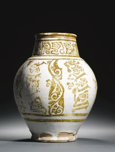 A Large Fatimid white-ground lustre pottery jar, Egypt, 10th/11th century