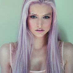 Okay, I don't know what's up with her eyebrows, but I love the purple streaks in her blonde!