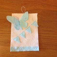 Étiquette papillon turquoise