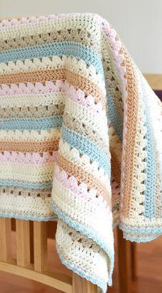 Crochet cozy, pastel-soft blanket