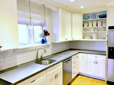 White Kitchen With Gray Concrete Countertops. Endless Concrete Design, Pa.