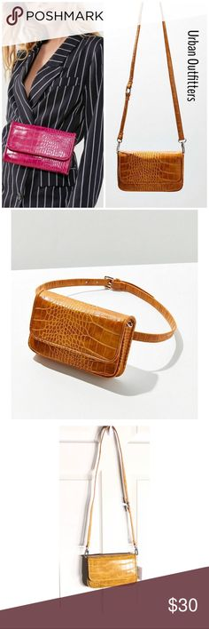 UO LERA CROC CONVERTIBLE BELT/CROSSBODY BAG NWT, gorgeous UO Convertible Belt Crossbody Bag. This belt/crossbody bag combo  features flat-front with snap closure, faux leather with shiny finish, inner lining. Adjustable straps that detaches and can be worn around the waist, hips or over the shoulder. Very versatile and stylish. Color: Mustard. Line tag to prevent store returns. Bundle and save. Urban Outfitters Bags Crossbody Bags