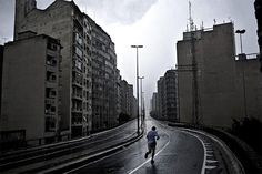 "Sao Paulo. Calros Cazalis. The ""Minhocão"" eleated expressway ges closed for pedestrians and bikers every Sunday"