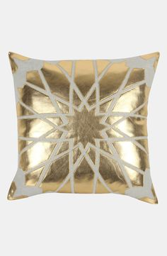 Gold accents for the living room | Metallic faux leather & earthy linen pillow.