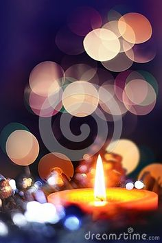 Christmas candle in atmospheric light with bokeh