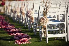Decorate your aisle with hydrangea pomanders and curly willow branches.Photo by: La Dolce Vita Studio on Every Last Detail via Lover.ly