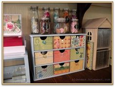Paper Loves Glue: Drawers covered with pretty paper and button pulls.