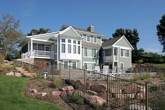 Beautiful Cottage exterior - back patio with pool, overlooking Lake Michigan