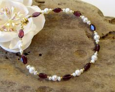 Hey, I found this really awesome Etsy listing at https://www.etsy.com/listing/257636765/garnet-and-freshwater-pearl-bracelet