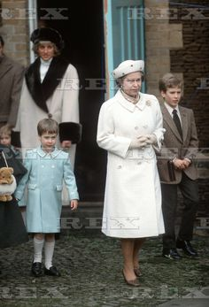 3 jan 1988, 5 yr,old Prince William, and 10 yr. old, Peter Phillips walk alongside their grandmother, the Queen.