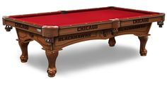 NHL Chicago Blackhawks Pool Table comes in an 8-foot length. The Wood cabinet has CNC and laser cut logos. Choose from 2 finishes, 22 colors. Free installation. Visit SportsFansPlus.com for Details.