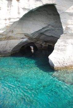 rocks morphing into caves, Milos, Greece