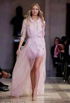 Pretty in pink: Carolina presented a series of flowing, sheer dresses in pink and white fo...