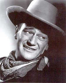 John Wayne ...  Appeared in dozens of westerns between 1930-1939; was the first singing cowboy in Riders of Destiny, 1933 ...