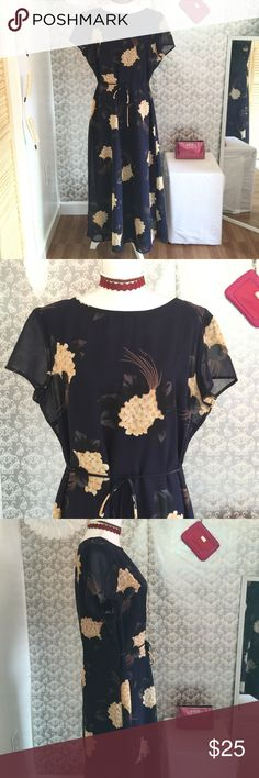 Navy/floral print shirt sleeve dress Like new 53 inches in length 20 inches in width zipper closure down back has purple satin lining fabric 100% polyester dry clean only Ed michaels  Dresses