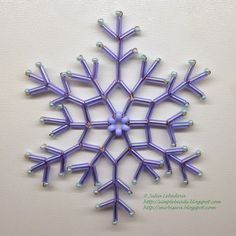 Free detailed tutorial with step by step photos on how to make a snowflake out of seed beads, bugle beads and wire. Great for beginners!