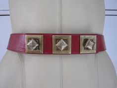 Betsey Johnson; red patent belt with amazing brass locking stud fastening 28-32