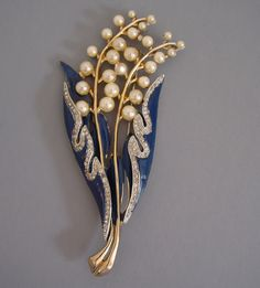 CORO lily-of-the-valley brooch with navy enamel leaves, artificial pearl flowers all set in gold tone, circa 1941