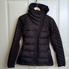 NWOT Lululemon Run What The Fluff Jacket SZ 4 NWOT, w/hang tag! RARE!  Convertible insulated run jacket so you can customize the function for any run (Removable hood insert, zip it in for added warmth or remove it on warmer days). Drop the skirt for extra splash protection or remove the hood when winds aren't blowing Wind and water resistant fabric for any kind of weather 800 fill power premium Goosedown has a high warmth to weight ratio Stretchy Rulu panels are breathable and inherently…