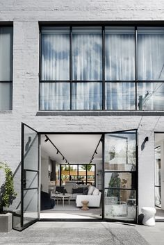 Bell Street House was designed by Techne Architecture + Interior Design. View this architecture archive & more at The Local Project.