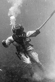 Operation Crossroads • Bikini Atoll underwater diver Charles Gaerke • July 1946 • Atom Bombs, the tests. They wanted to see the effects of the bomb on ships when bombs were exploded above and below the water. The Navy got 30 Photographers to volunteer to train as underwater divers so we could take pictures of the damage to the ships that sank from the explosions.
