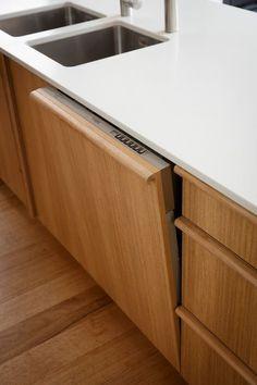 modern oak caibnetry | white counter | mid century modern | west coast | Reno Rumble Kitchen Reveals - Freedom Kitchens - Hidden Dishwasher - Intesgrated Dishwasher