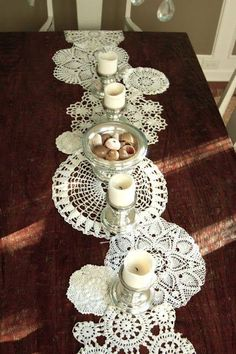 Old doilies. Here's a great idea to display them. Old doilies are sewn together make a table runner. Anyone remember doilies on furniture--on arms or backs of upholstered chairs?