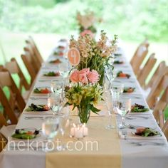 Table with runner and flowers
