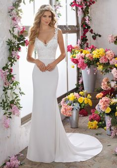 Designer Wedding Dresses and Bridal Gowns by Morilee. Embroidered AppliquŽés Adorn the V-Neck and Bodice on This Beautiful Crepe Sheath Wedding Gown.