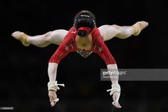 Jiaxin Tan of China competes on the uneven bars during Women's qualification for Artistic Gymnastics on Day 2 of the Rio 2016 Olympic Games at the Rio Olympic Arena on August 7, 2016 in Rio de Janeiro, Brazil.  (Photo by David Ramos/Getty Images)