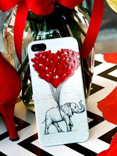 Do you love elephants and hearts?  Then this may be the perfect cellphone case for you.  On sale now for only $15. #elephantsrule