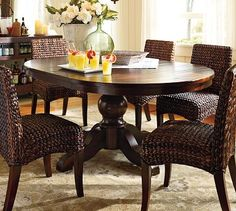 Love the look of the wicker chairs with the dark wood table - formal, yet comfortable