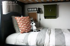 "(Boys bunk beds 2 of 5) Adorable young boy's bunk bedroom for two❣ Love the details—letters spelling ""Guest"" for the bottom bunk when friends stay over (plus the boys' names for top bunks) • personal lamps • bulletin boards • little metal lockers at each bunk for keepsakes—genius ideas❣ The stuffed raccoon is perfect for this camping style decor & may have been the inspiration❣ Jones Design Company"