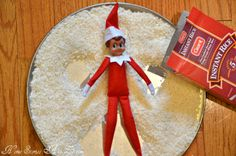 Elf on the Shelf making a snow angel in rice.