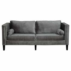 Sleek and chic, this velvet-upholstered sofa brings a stylish touch to your favorite spaces with its track arms and nailhead trim.    ...