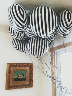 REVEL: Black and White Striped Balloons. I want these in my house at all times