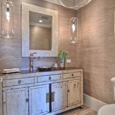 Beautiful wall cover and lights w/distressed cabinet repurposed for a bathroom.