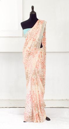 For Bollywood night or cocktail parties... wrapped just right, with bangles in summer blue, this sari would be gorgeous.