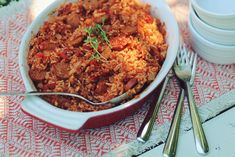 Charleston Red Rice with Sausage Recipe Main Dishes with chicken sausage, rice, onions, bell pepper, garlic cloves, brown sugar, old bay seasoning, tomato paste, stewed tomatoes