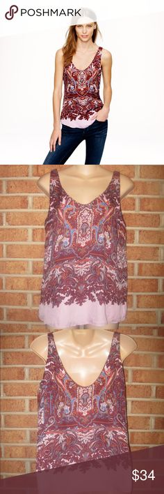 J Crew Cate Cami Tank Top in Iced Lilac Paisley Style number 07094. Size: 2. Length: Approximately 25 inches. Approximately 17 inches from armpit to armpit. Pullover style. Iced Lilac Paisley print. Bra keeps. Lined. 100% Silk. Lining is 100% Polyester. J. Crew Tops