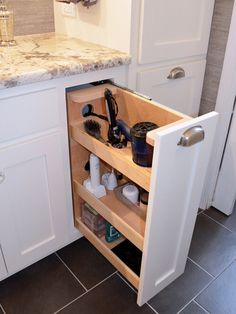 Hair dryer and daily toiletries cabinet draw with outlets  Also like the flooring!