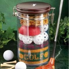 Clubhouse Collection Golfers Jar 'O' Gifts. All the accessories a golfer needs! Contains: Airtight storage canister Over fifty tees 5 USGA approved golf balls cotton golf towel Ball washer. Golf Gifts, Gifts For Kids, Diy Father's Day Gifts Easy, Best Gifts, Unique Gifts, Great Gifts For Dad, Fathers Day Crafts, Gadget Gifts, Fundraising Events