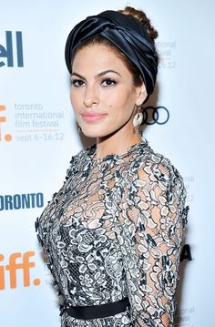 Eva Mendes looks stunning waring a satin turban and lace dress