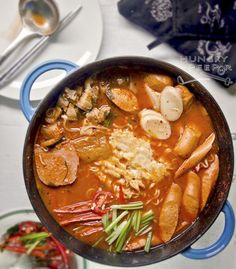 """Translating to """"army stew"""", Budae Jjigae traditionally incorporates preserved meats and sausages and whatever vegetables are on hand. Korean Dishes, Korean Food, Veggie Recipes, Asian Recipes, Ethnic Recipes, K Food, Food Porn, Budae Jjigae Recipe, Japan Street Food"""