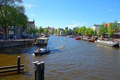 AMSTERDAM EXPLORER With the buzz of a big city and charm of a little village, let Amsterdam's tree-lined canals captivate you. Amsterdam Holidays, Amsterdam Travel Guide, Fire Art, Countries To Visit, Solo Travel, Netherlands, Cruise, Boat, Tours