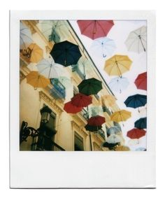 Umbrellas as rain - polaroid fine art print in 8x10 inches signed by its author http://www.etsy.com/listing/93289359/umbrellas-as-rain-polaroid-fine-art?ref=cat1_gallery_16