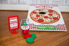 Pizza hole diy corn hole game for a pizza birthday party!