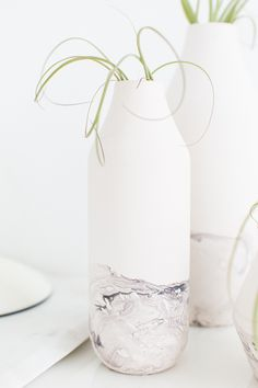 Make an inexpensive vase look way more elegant with this tutorial for DIY Marble Dipped Vessels! Can you believe we achieved this look with nail polish?