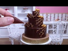 A tiny miniature dark chocolate wedding cake, decorated with chocolate roses in a bunch, little clusters of gold sugar buds, and brushed with edible gold dus. Mini Cake Pans, Mini Cakes, Tiny Cooking, Chocolate Roses, Chocolate Decorations, Mini Foods, Coffee Set, Asmr, Sprinkles